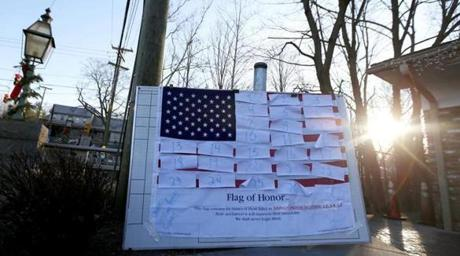 An American flag covered with numbers representing the people that died when a gunman opened fired at Sandy Hook Elementary School was displayed.